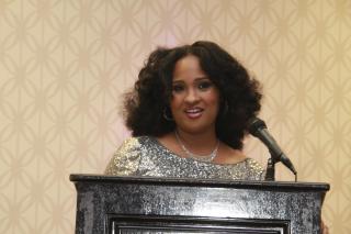 Natasha Bowman accepting Visionary Leadership Award